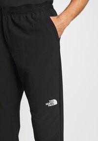 The North Face - MENS ACTIVE TRAIL JOGGER - Długie spodnie trekkingowe - black - 4