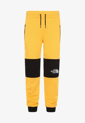 HIMALAYAN - Tracksuit bottoms - yellow/black