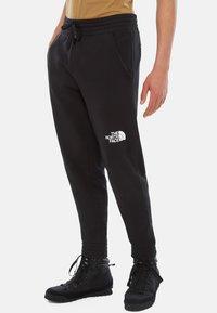 The North Face - STANDARD PANT - Spodnie treningowe - black - 0