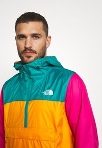 The North Face - MENS FANORAK - Veste coupe-vent - orange/teal/pink - 3
