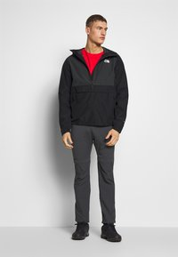 The North Face - MEN'S WATERPROOF FANORAK - Veste coupe-vent - black - 1