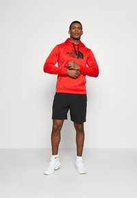 The North Face - MENS SURGENT HOODIE - Sweat à capuche - fiery red heather - 1