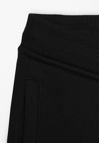 The North Face - SLIM FIT - Tracksuit bottoms - black - 2
