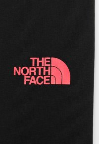 The North Face - SLIM FIT - Tracksuit bottoms - black - 3