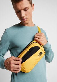 The North Face - BOZER HIP PACK - Bum bag - yellow/black - 1