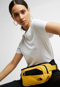 The North Face - BOZER HIP PACK - Bum bag - yellow/black - 5