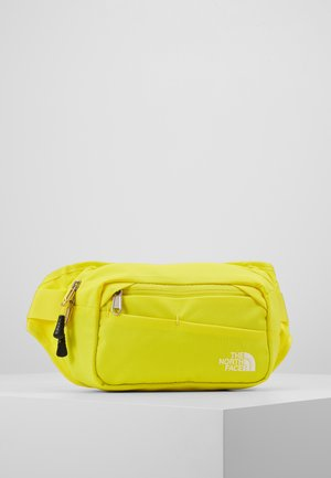 BOZER HIP PACK UNISEX - Across body bag - lemon/black