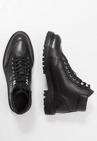 The Kooples - Šněrovací kotníkové boty - black - 1