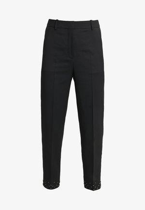 PANTALON - Trousers - black / silver