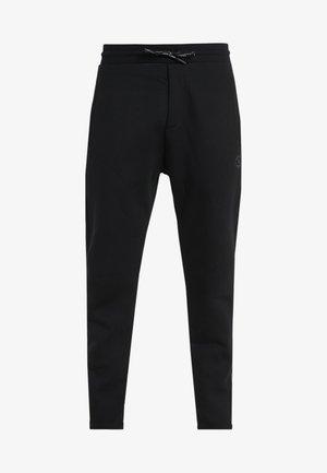 JOGGING - Teplákové kalhoty - black