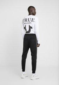The Kooples - JOGGING - Pantalon de survêtement - black - 2
