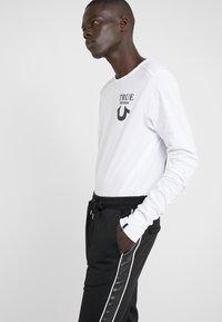 The Kooples - JOGGING - Pantalon de survêtement - black - 3
