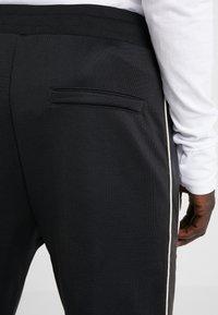 The Kooples - JOGGING - Pantalon de survêtement - black - 6