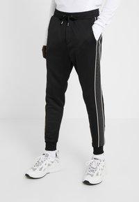 The Kooples - JOGGING - Pantalon de survêtement - black - 0
