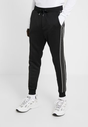 JOGGING - Trainingsbroek - black