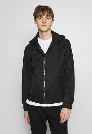 HOODED LIGHT JACKET - Summer jacket - black