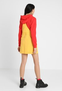 The Ragged Priest - PINAFORE DRESS - Denní šaty - yellow - 2