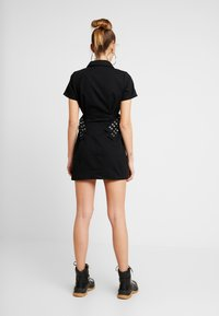 The Ragged Priest - DRILL FITTED  DRESS WITH BUCKLE EYELET DETAIL - Farkkumekko - black - 3