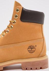 Timberland - 6 INCH PREMIUM - Winter boots - wheat - 9