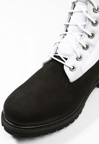 Timberland - Lace-up ankle boots - black - 5