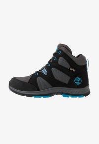Timberland - NEPTUNE MIDGTX BUNG - Winter boots - black - 1