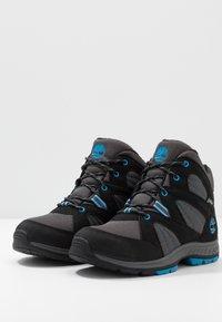 Timberland - NEPTUNE MIDGTX BUNG - Winter boots - black - 3