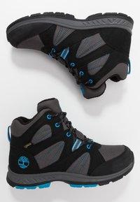 Timberland - NEPTUNE MIDGTX BUNG - Winter boots - black - 0