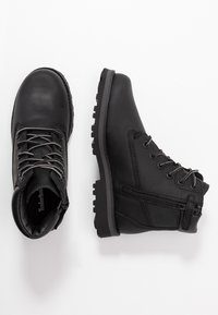 Timberland - COURMA TRADITIONAL - Lace-up ankle boots - black - 0