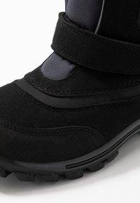 Timberland - CHILLBERG 2-STRAP GTX - Winter boots - black - 2