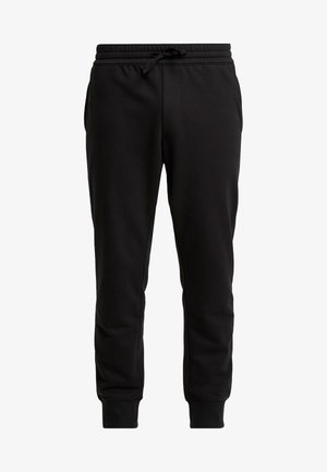 CORE ESTABLISHED 1973 - Tracksuit bottoms - black