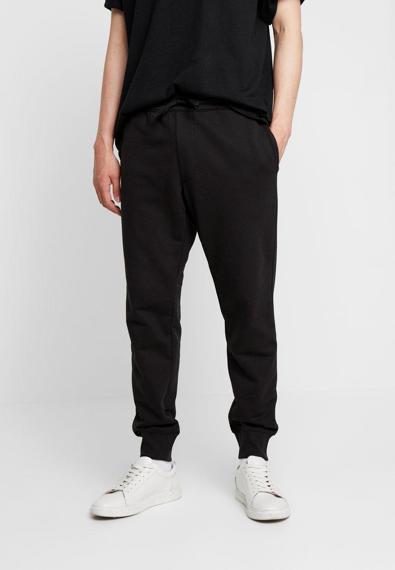 Timberland - CORE ESTABLISHED 1973 - Pantalon de survêtement - black