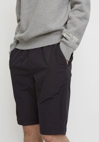 Timberland - WOODWOOD 2IN1 HIKE PANT - Tracksuit bottoms - obsidian - 3