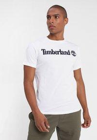 Timberland - CREW LINEAR  - Print T-shirt - white - 0