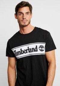 Timberland - CUT & SEW TEE - Print T-shirt - black - 4