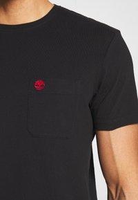 Timberland - DUNSTAN RIVER POCKET SLIM TEE - Basic T-shirt - black - 4
