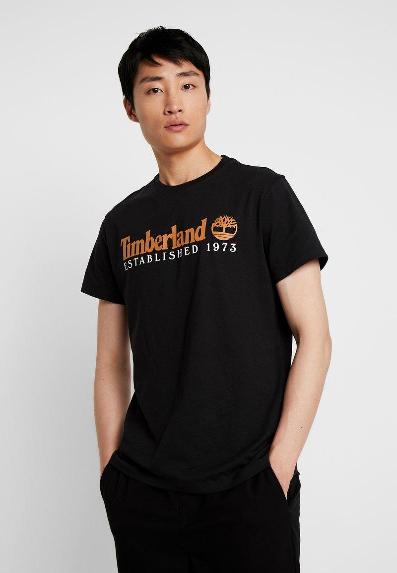 Timberland - ESTABLISHED TEE - T-shirt con stampa - black