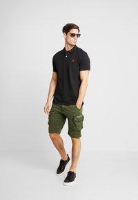 Timberland - Koszulka polo - black - 1