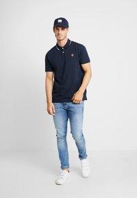 Timberland - TIPPED - Polo shirt - dark sapphire - 1