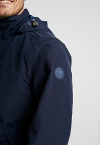 Timberland - RAGGED MOUNTAIN RAINCOAT  - Waterproof jacket - dark sapphire - 7
