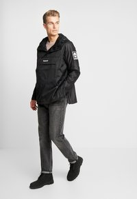 Timberland - OUTDOOR ARCHIVE HOODED - Giacca a vento - black - 1