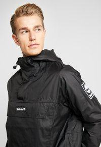 Timberland - OUTDOOR ARCHIVE HOODED - Giacca a vento - black - 3
