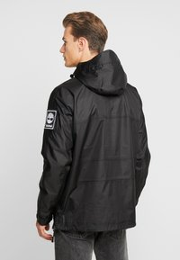 Timberland - OUTDOOR ARCHIVE HOODED - Giacca a vento - black - 2