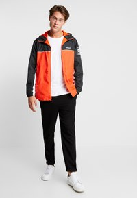 Timberland - FULL ZIP JACKET - Summer jacket - black/spicy orange - 1