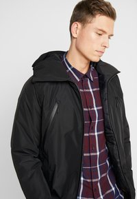 Timberland - THERMA RANGE ULTIMATE WINTER - Cappotto invernale - black - 5