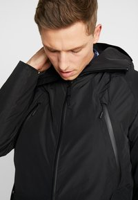 Timberland - THERMA RANGE ULTIMATE WINTER - Cappotto invernale - black - 7