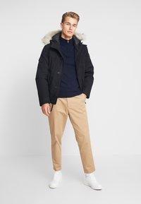Timberland - SCAR RIDGE SNORKEL DOWNFREE - Winter jacket - black - 1