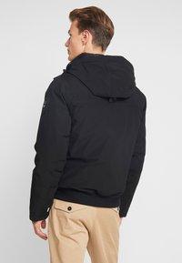 Timberland - SCAR RIDGE SNORKEL DOWNFREE - Winter jacket - black - 3