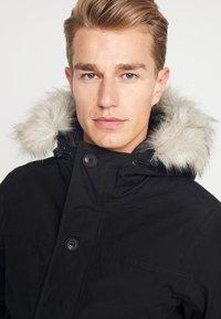 Timberland - SCAR RIDGE SNORKEL DOWNFREE - Winter jacket - black - 4