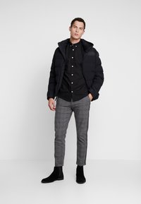 Timberland - UPDATE SOUTH TWIN JACKET - Winterjacke - black - 1