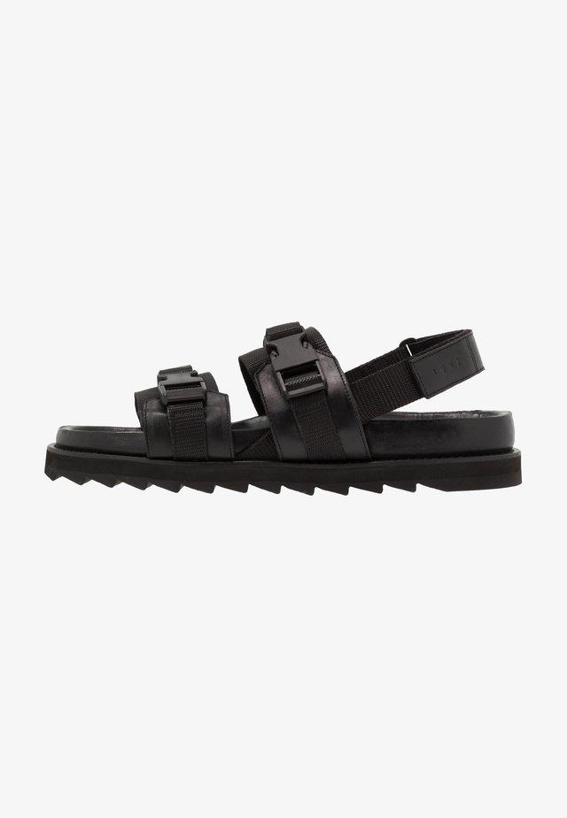 JORAN - Sandaalit nilkkaremmillä - black